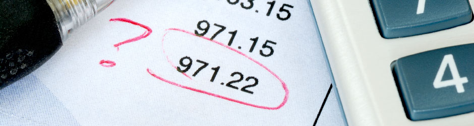 Financial figures with one circled in red beside a question mark.