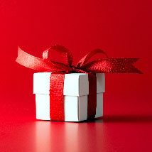 A small gift with a red bow.